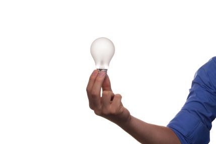 man holding bulb in his right hand