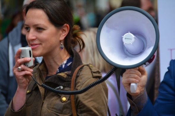 Woman with megaphone at protest