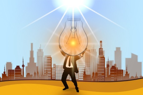person using a light bulb on the sun in front of a city landscape