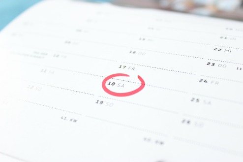 A calendar with a red circle around a date